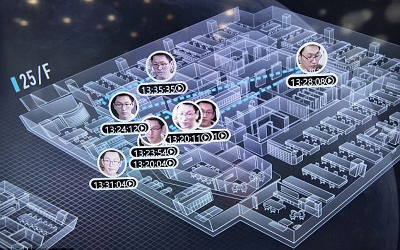 The system has been helping Shanghai's police force track down criminals in a city with more than 24 million inhabitants. Pictured is Dragonfly Eye tracking employees in Yitu Technology's Shanghai headquarters.